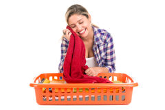 Laundry. Positive young woman doing the laundry at home stock image