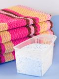 Laundry powder. Washed wipers and measure with laundry powder Stock Photos