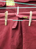 Laundry: red washing hanging on line Royalty Free Stock Images