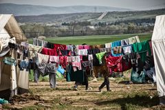 Refugee crisis in Europe. Laundry in the refugee camp in Idomeni, Greece, march 2016 stock image