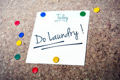 Laundry Reminder For Today On Paper Pinned On Cork Board Stock Photography