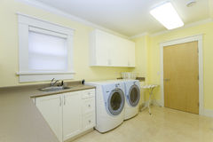 Laundry room. With a sink and a washer and dryer Royalty Free Stock Photo