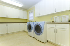 Laundry room. With a washer and dryer Stock Image