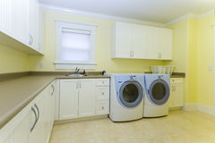 Laundry room. With a sink and a washer and dryer royalty free stock photos