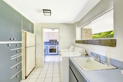 Laundry room with built-in cabinets Stock Photo