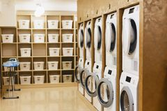 laundry room with driers and dryers royalty free stock photos