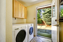 Laundry room with exit to backyard area Royalty Free Stock Image