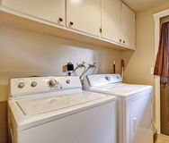 Laundry room with exit to backyard Stock Image