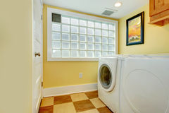 Laundry room with glass block window Stock Images