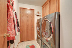 Laundry room interior with modern stainless steel appliances Stock Images