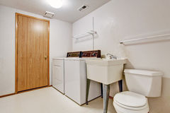 Laundry room interior in old house Stock Image