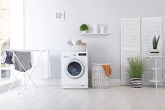 Laundry room interior with washing machine. Near wall stock photos