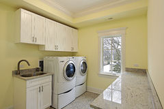 Laundry room in luxury home stock image