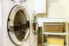 Laundry room with modern appliaces Stock Photography