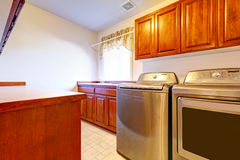 Laundry room with modern steel appliances Stock Photos