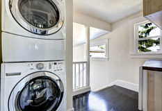 Laundry room with modern white appliances stock images