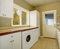 Laundry room with tile counters and sink. Stock Photography
