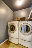 Laundry room with tile floor, washer, and dryer. Royalty Free Stock Image