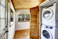 Laundry room with view to fenced back yard Stock Photos
