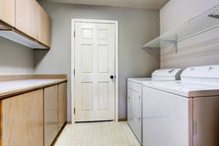 Laundry room with washer and dryer with tile floor. Stock Photography