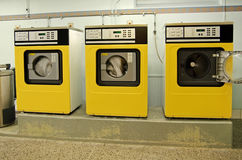 Laundry room with washing machines Stock Images