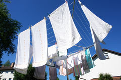 Laundry on a rotary clothes dryer Royalty Free Stock Image