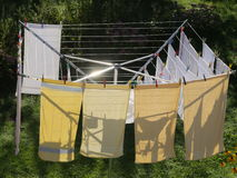 Laundry on a rotary dryer Stock Images