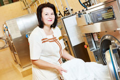 Laundry services. woman with washing machine Royalty Free Stock Image