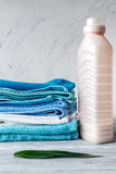 Laundry set with towels and plastic bottels on gray background mock up Royalty Free Stock Images