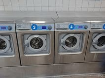 Laundry shop. Berlin, Germany - June 25, 2018: Electrolux washing machines in a laundry shop. Electrolux AB is a Swedish multinational home appliance royalty free stock photography