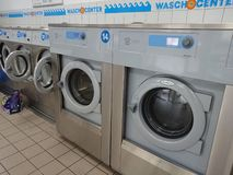 Laundry shop. Berlin, Germany - June 25, 2018: Electrolux washing machines in a laundry shop. Electrolux AB is a Swedish multinational home appliance royalty free stock image
