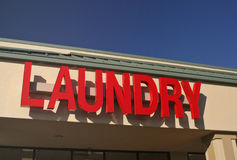 Laundry Sign. On Building With Blue Sky Stock Photography