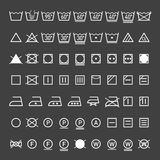 Laundry symbols collection. On black Stock Photography