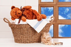 Laundry With Teddy. Laundry basket with freshly laundered white towels and teddy bear Stock Photography