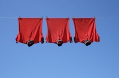 Laundry, Three Red T-shirts Stock Photo