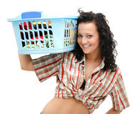 Laundry time. Attractive young woman with the laundry basket on her shoulder Royalty Free Stock Images