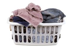 Laundry time. A laundry basket full of clothes royalty free stock image