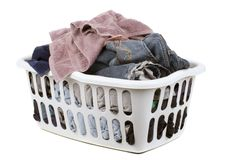 Laundry time. A laundry basket full of clothes royalty free stock photography