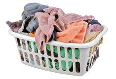 Laundry time. A laundry basket full of clothes royalty free stock photos