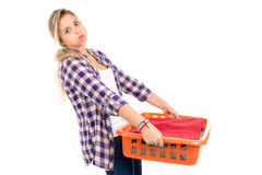 Laundry. Tired young woman doing the laundry at home royalty free stock photography