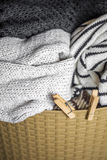 Laundry, warm clothes in the hamper Royalty Free Stock Image