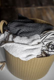Laundry, warm clothes in the hamper Stock Image