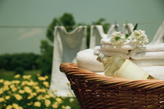Laundry wash. Clean towels freshly folded in wicker basket/ Retro color stock photography