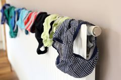 Laundry or washing drying on a domestic radiator.  stock image