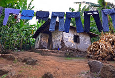 Laundry on a washing lines with mud brick house Royalty Free Stock Photos