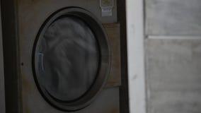 Laundry in washing machine. Laundry rotating in washing machine stock video