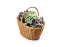 Laundry in wicker basket, isolated on white Stock Photography