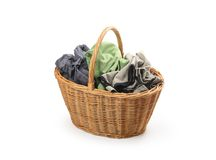 Laundry in wicker basket, isolated on white Royalty Free Stock Photo