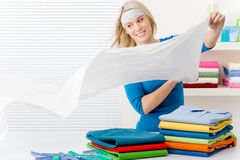 Laundry - woman folding clothes Stock Photos