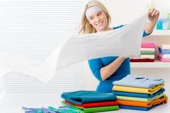 Laundry - woman folding clothes Stock Photos